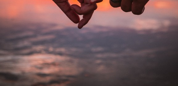 shallow-focus-photo-of-couple-holding-each-others-hands-3139497.jpg